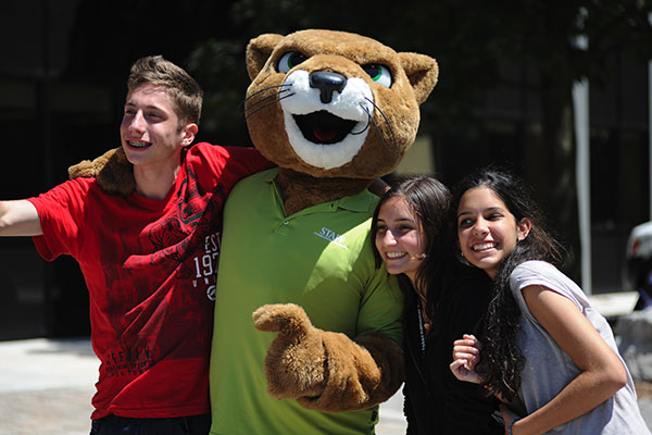 Students posing with Cicero the cougar, the school mascot