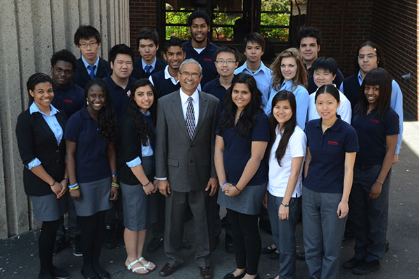 A group of diverse students and staff.