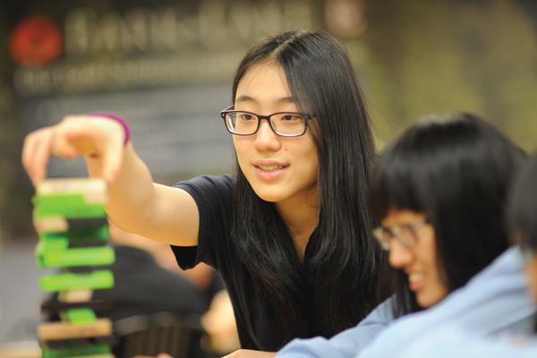 2 students playing Jenga